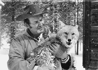 Dayton with one of his many wild animal rescues, a wolf
