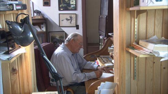 Dayton at his writing desk.